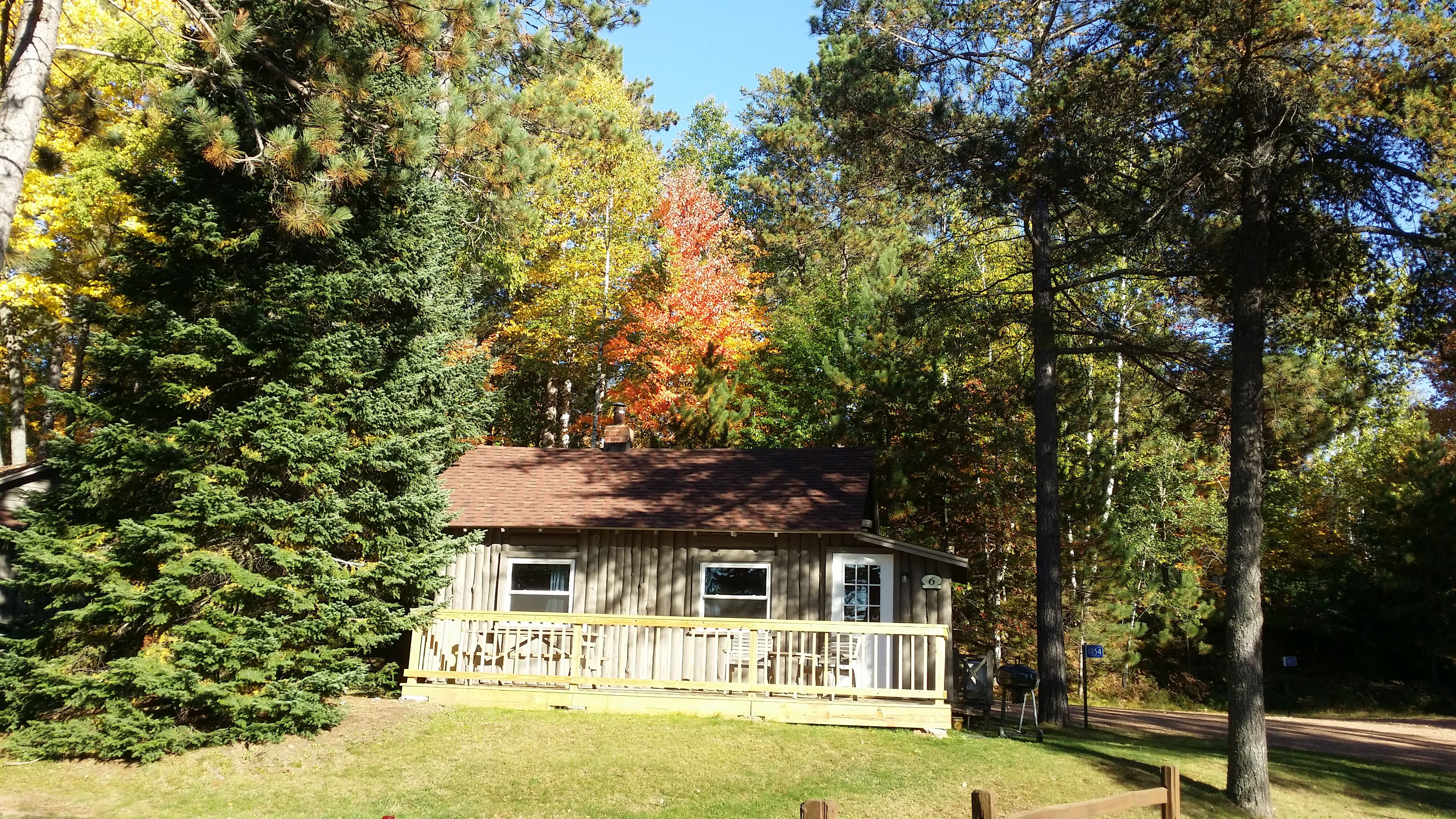 Warm and welcoming with fall colors and that big porch!